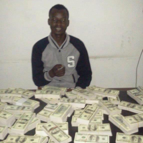 Yahoo boy shows off Dollars and Ritual Shrines full on money